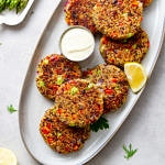 top down view of crispy quinoa cakes on a serving platter.