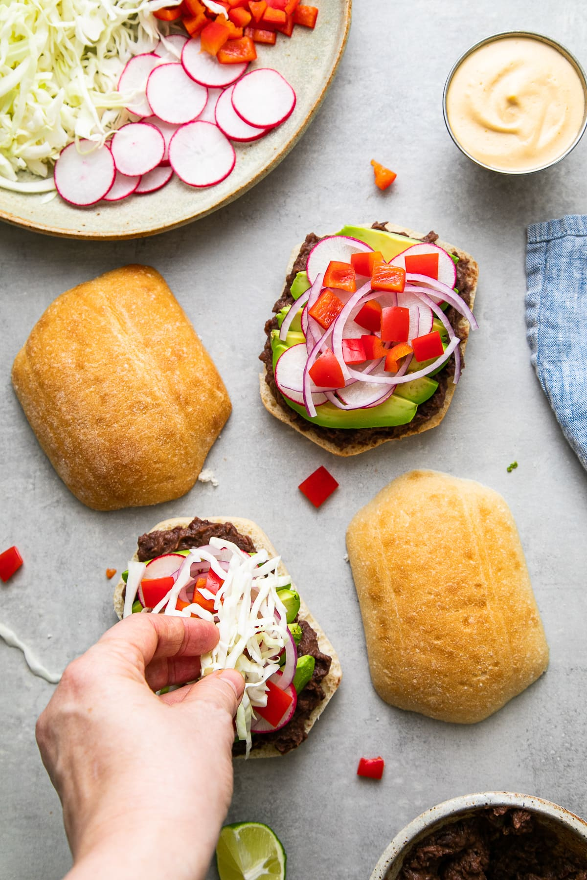 top down view showing the process of making black bean tortas.