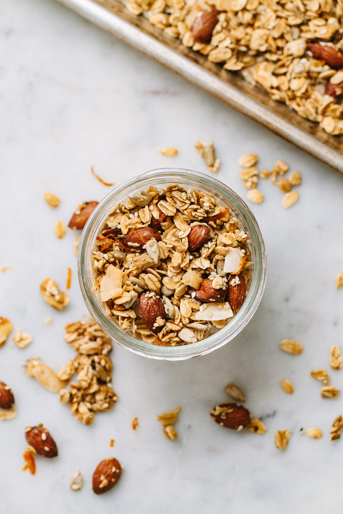 top down view of a small mason jar filled with oil free orange ginger granola.