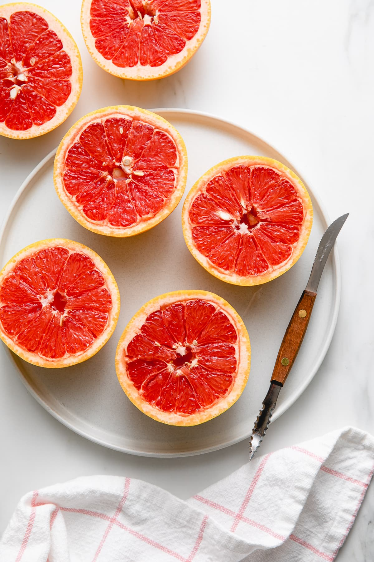 top down view of sliced grapefruit with segments cut.