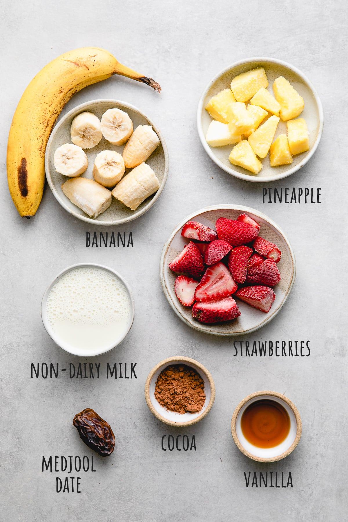 top down view of ingredients used to make vegan banana split smoothie recipe.