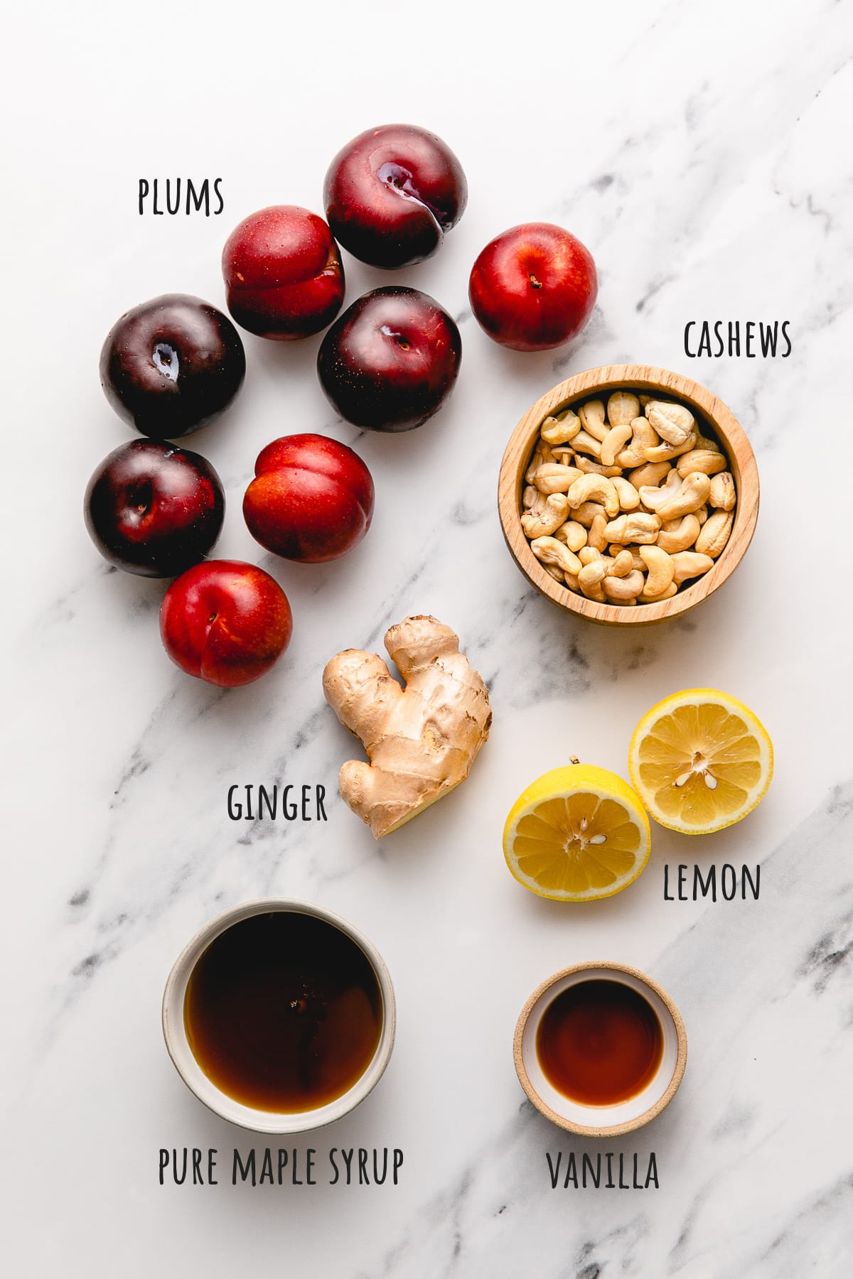 top down view of ingredients used to make healthy vegan fruit carpaccio with plums.