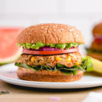 head on view of quinoa white bean veggie burger with all the fixings.