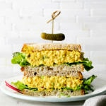 head on view of chickpea egg salad sandwich halves stacked.