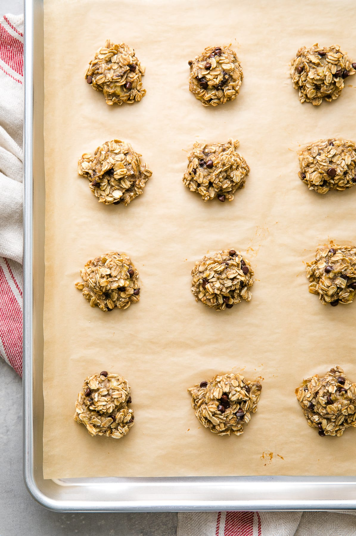 top down view of fresh baked banana oatmeal cookies on a baking sheet.