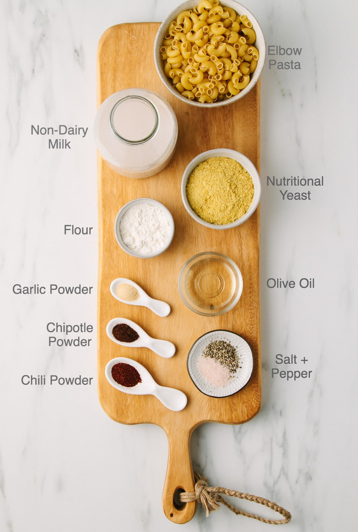 top down view of ingredients used to make vegan spicy mac and cheese recipe with nutritional yeast, flour and oil.