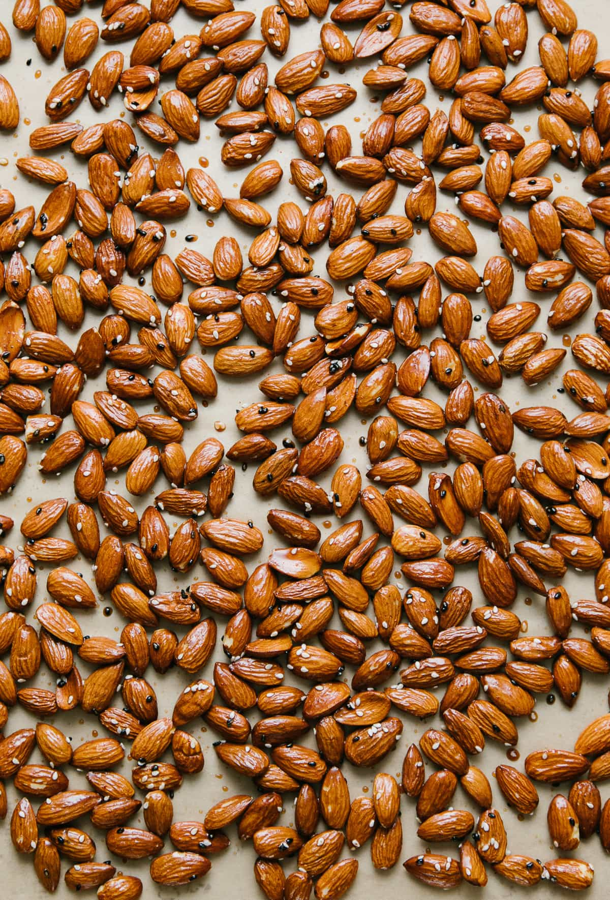 top down view of almonds seasoned, layered on a baking sheet and ready for the oven.