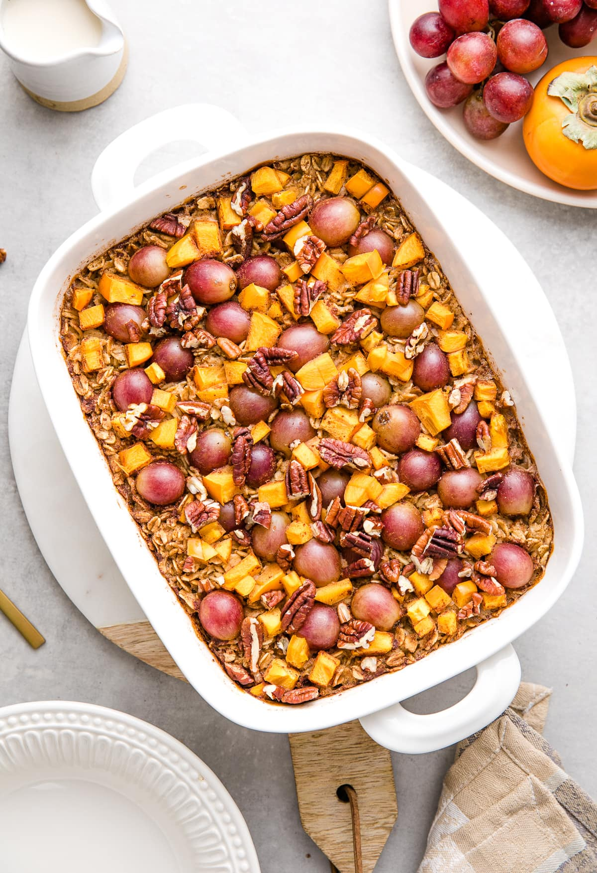 top down view of freshly made persimmon and grape baked oatmeal.