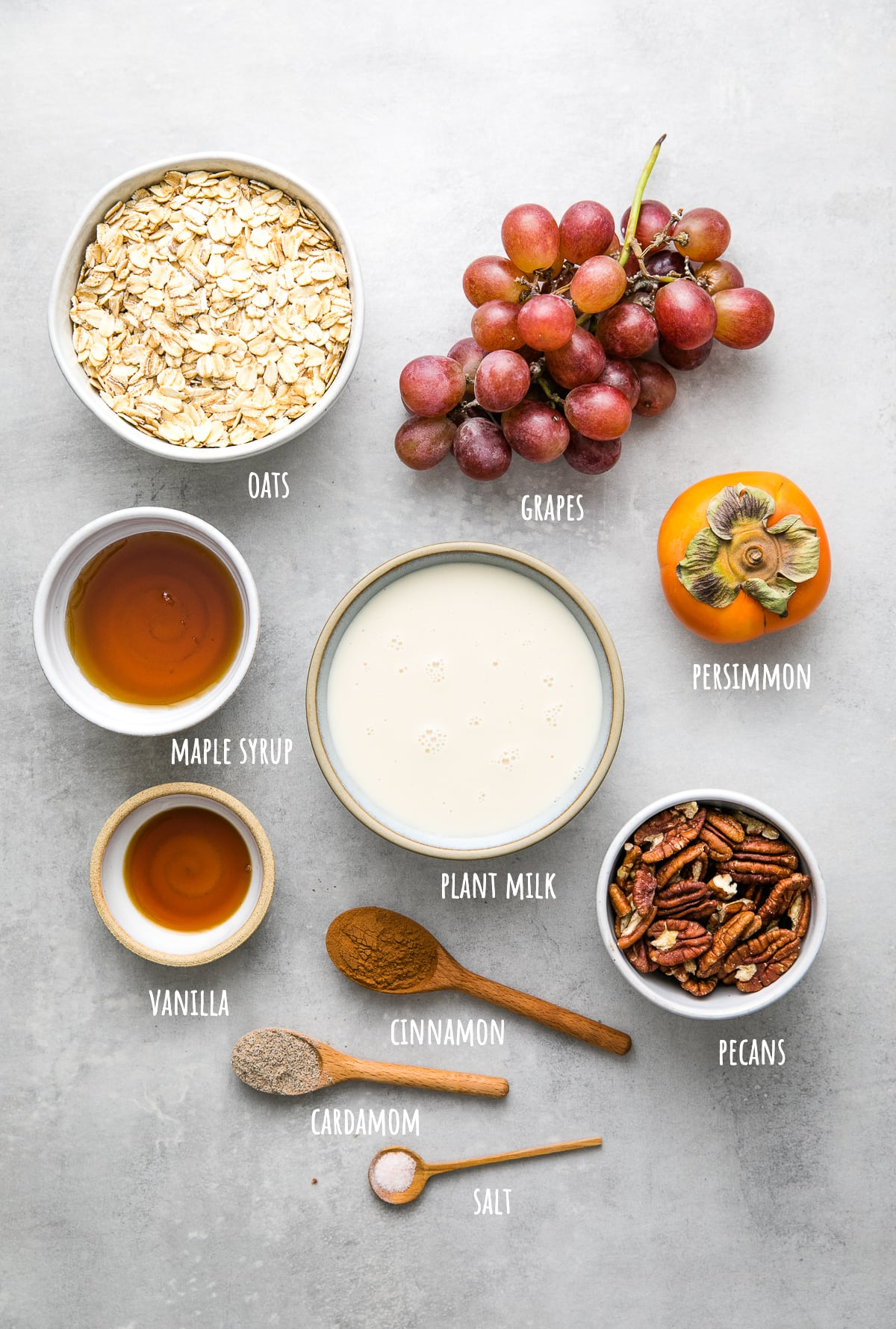 top down view of ingredients used to make healthy baked oatmeal with persimmon and grapes.