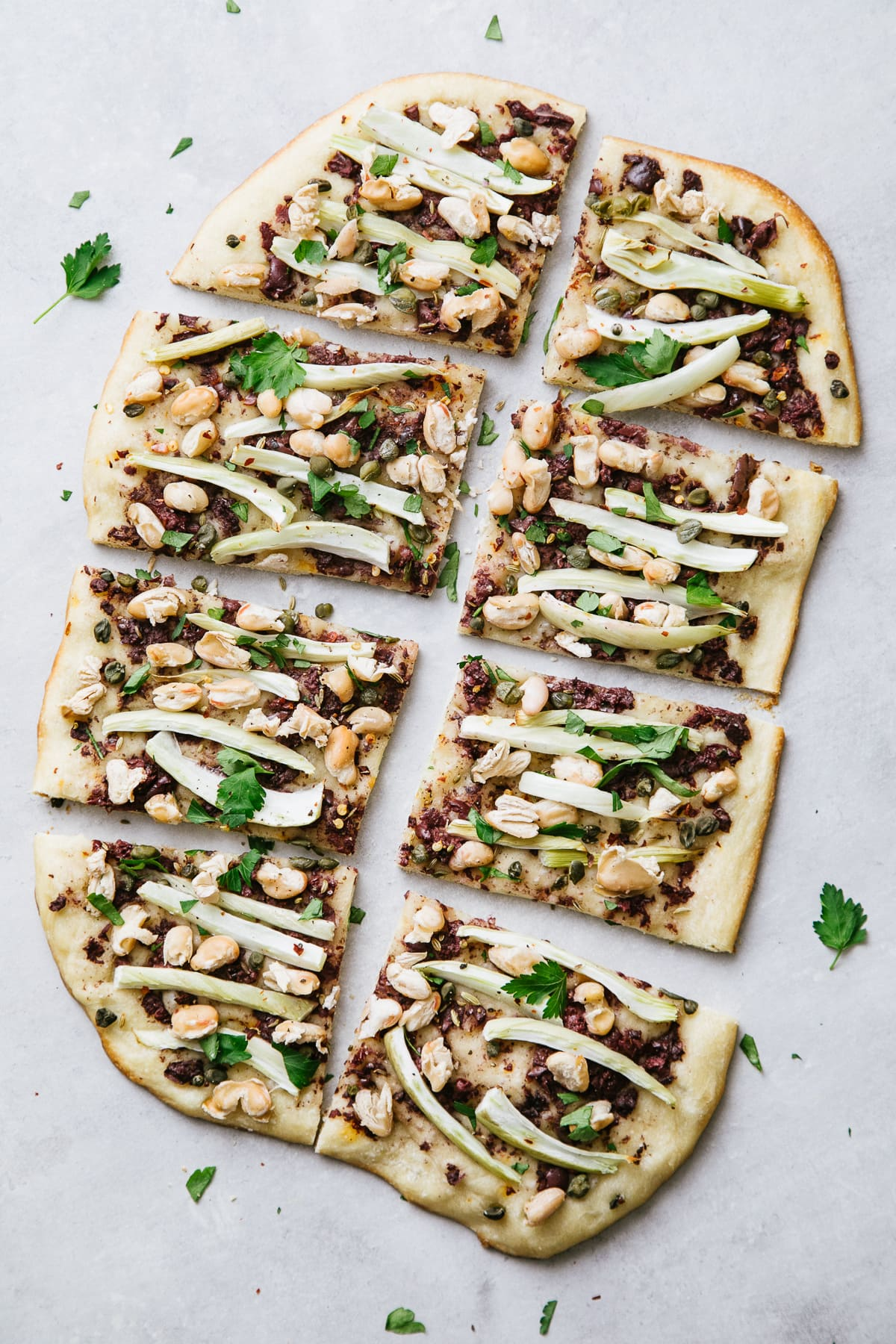 top down view of sliced cannellini fennel flatbread.