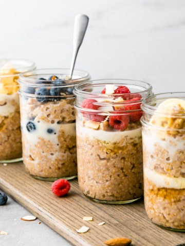 head on view of 4 steel cut breakfast jars with flavorful toppings.