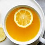 top down view of lemon ginger detox tea in a cup.