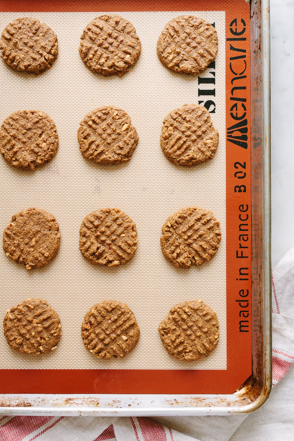 top down view of freshly baked 4 ingredient almond butter cookies on a baking sheet.