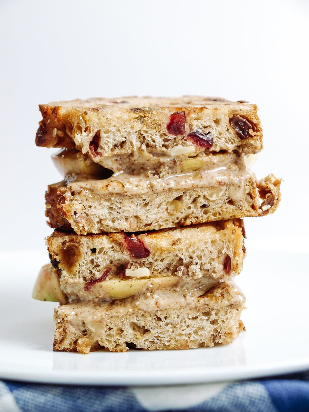 grilled peanut butter and apple sandwich cut in half and stacked on top of each other