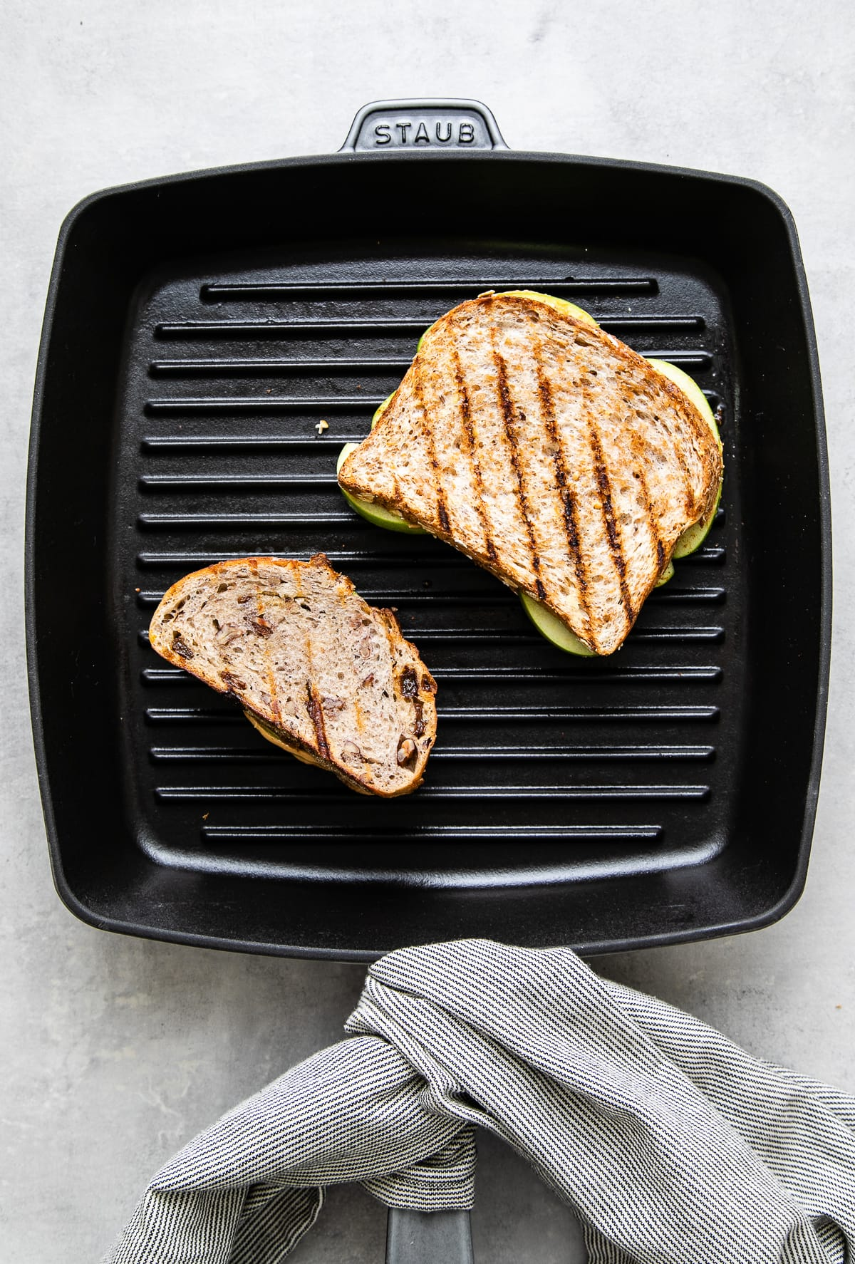 top down view of two sandwiches on a griddle.