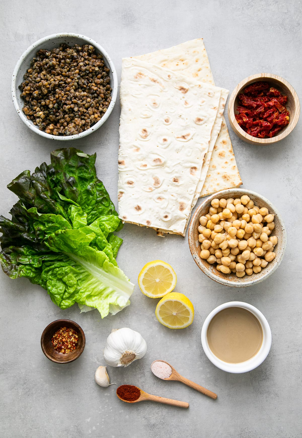 top down view of ingredients used to make lentil wrap with sun-dried tomato hummus.