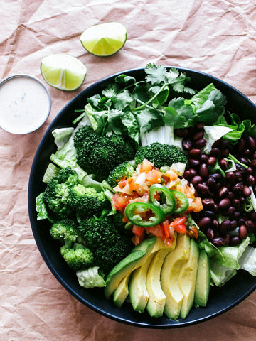 top down view of broccoli, avocado and black bean salad.