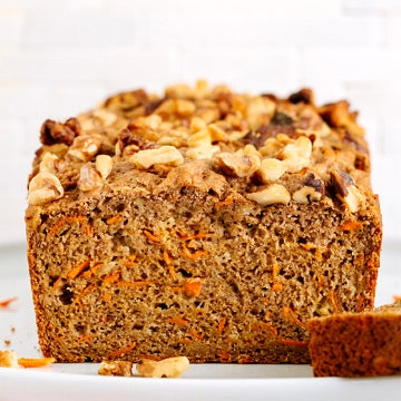 head on view of vegan carrot banana bread on a cake stand.