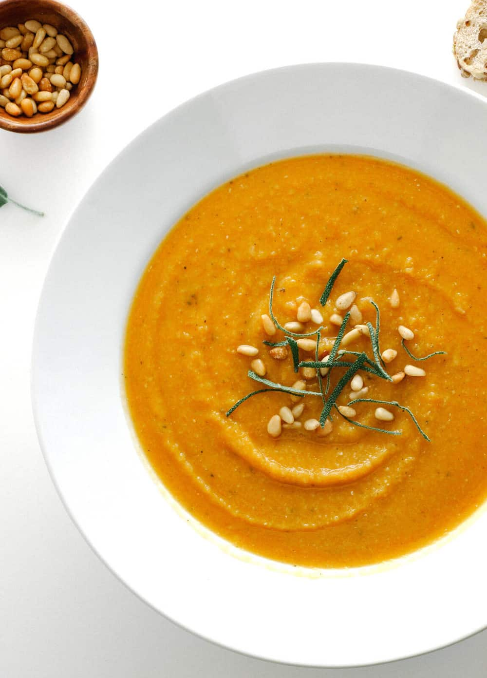 golden roasted butternut squash and red lentil soup in a white soup bowl
