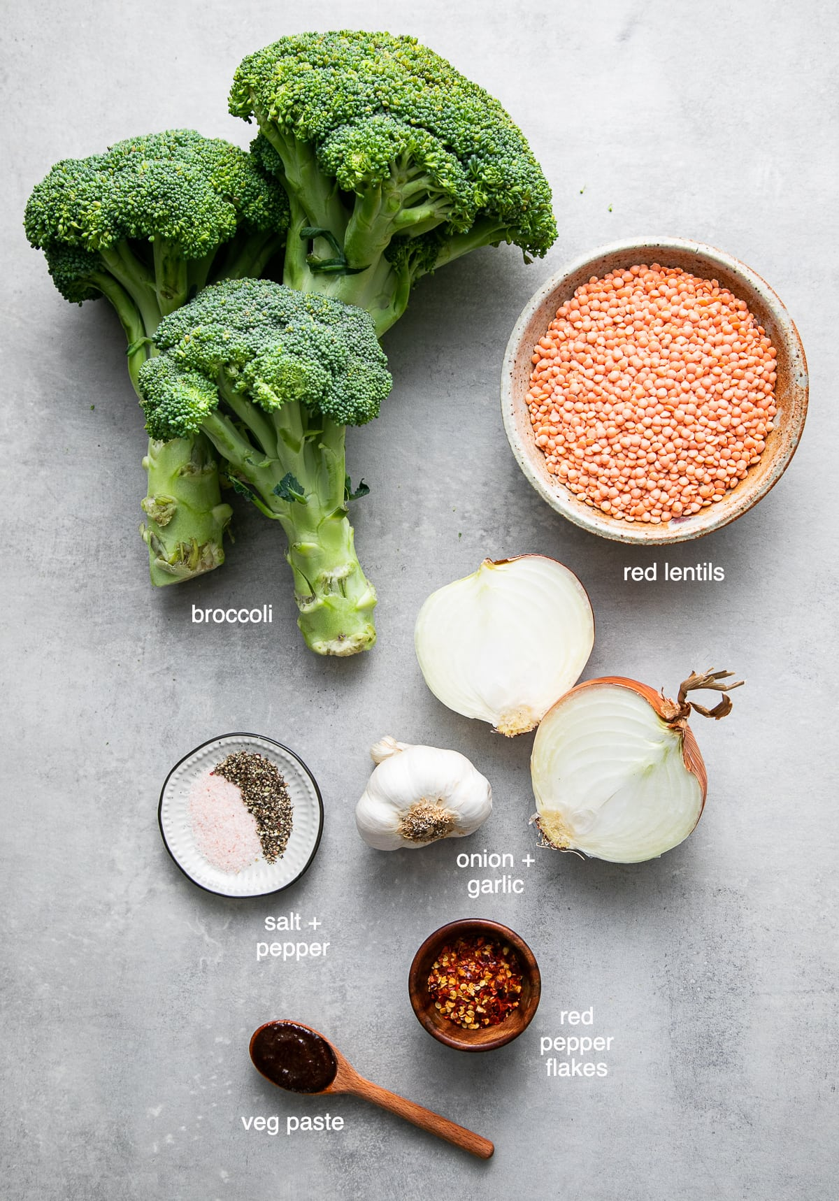 top down view of ingredients used to make creamy vegan broccoli red lentil soup recipe.