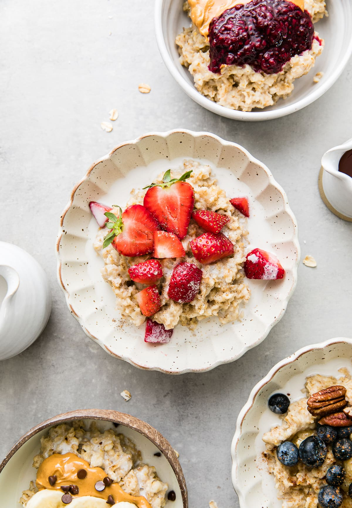 top down view of bowl of healthy oatmeal with strawberries and cream.