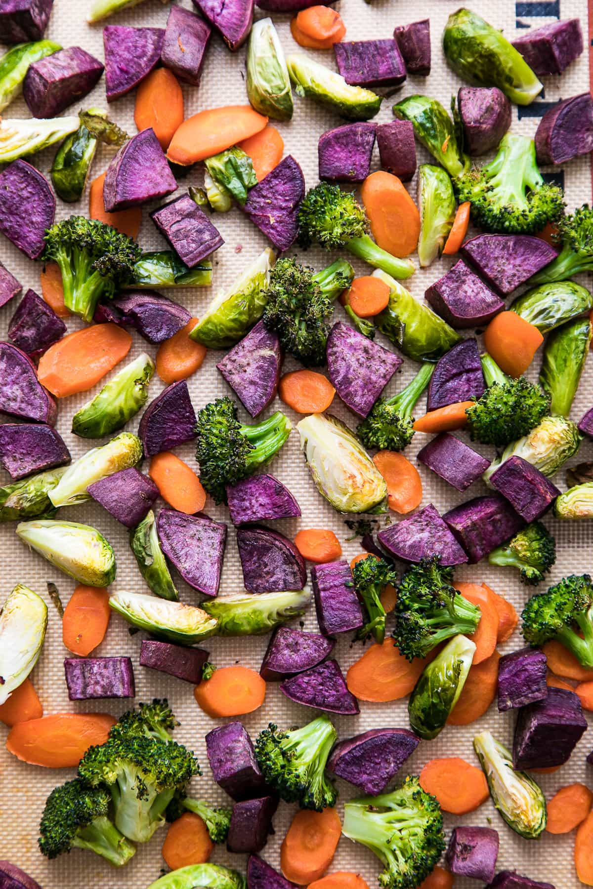top down view of roasted veggies on a baking sheet.