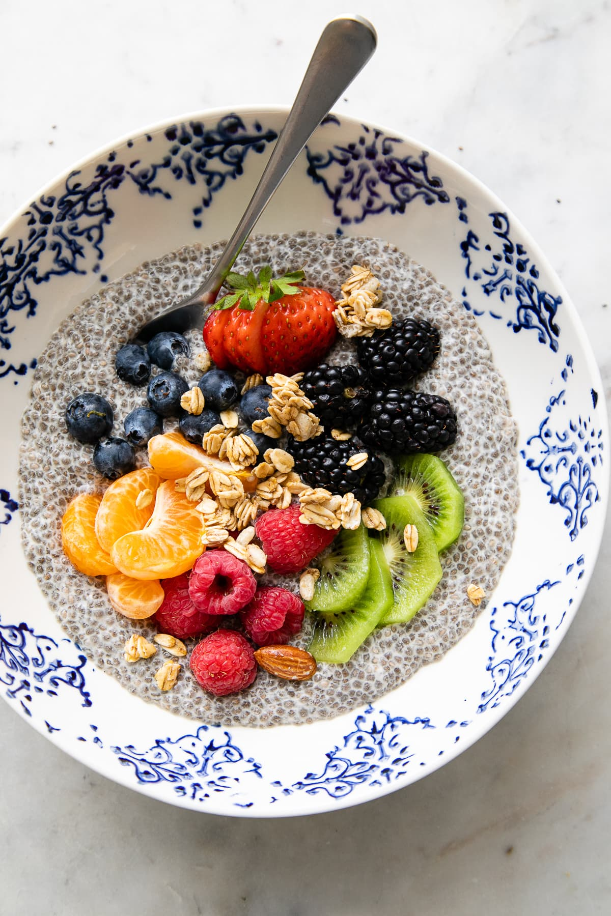 top down view of bowl with serving of chia pudding with a variety of fruit.
