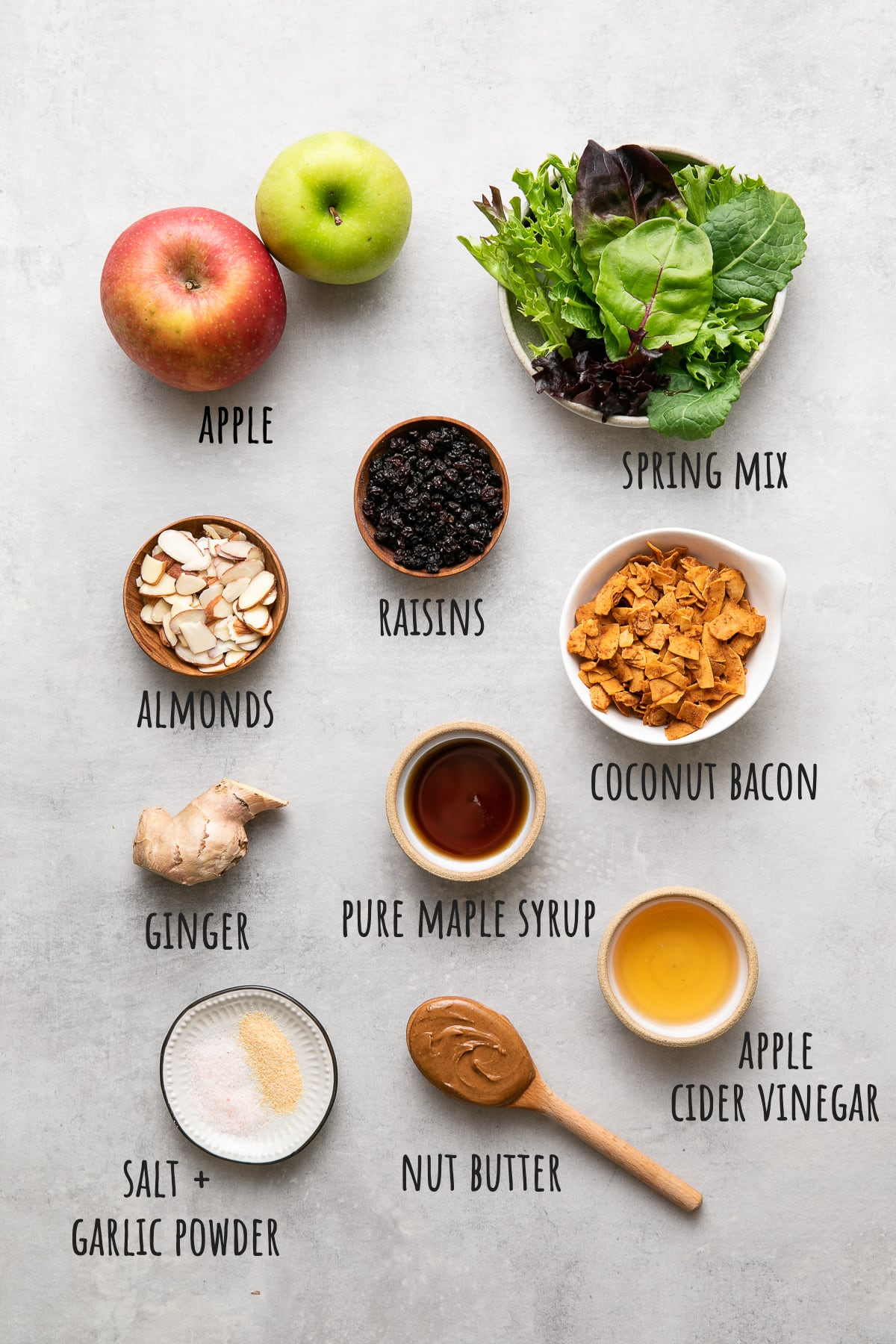 top down view of ingredients used to make apple coconut bacon salad recipe.