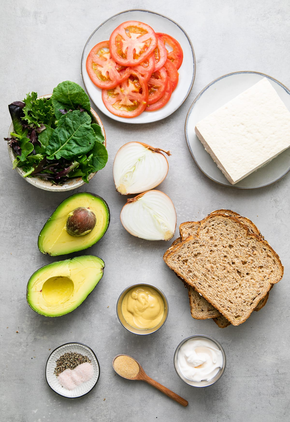 top down view of ingredients used to make the best tofu avocado sandwich.
