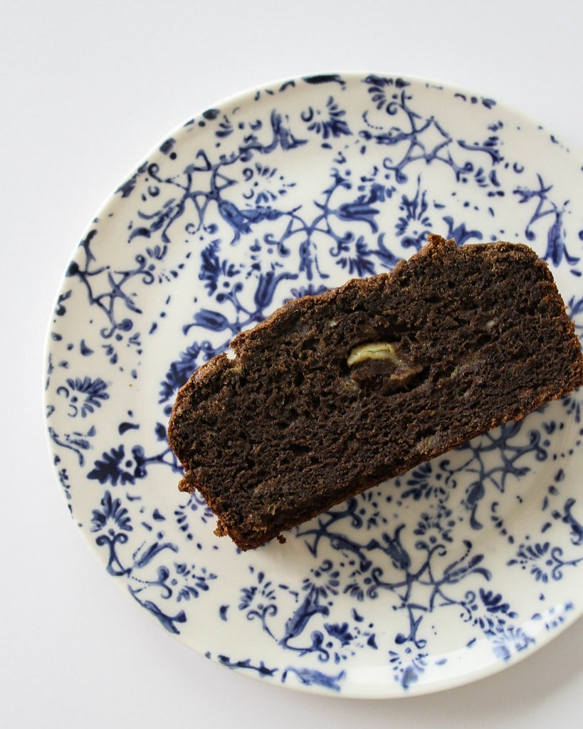 top down view of slice of healthy buckwheat banana bread on a blue and white plate.