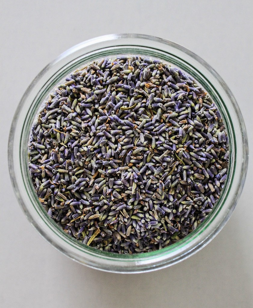 top down view of culinary lavender in a glass jar.