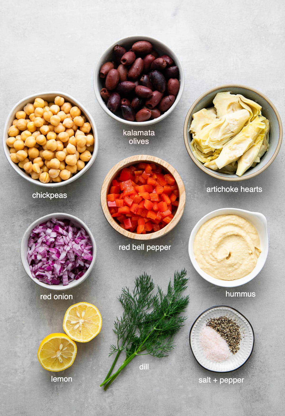 top down view of ingredients used to make mashed Mediterranean chickpea salad.