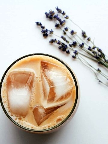 Lavender Chia Tea (Concentrate) served iced in a frosted glass with ice cubes