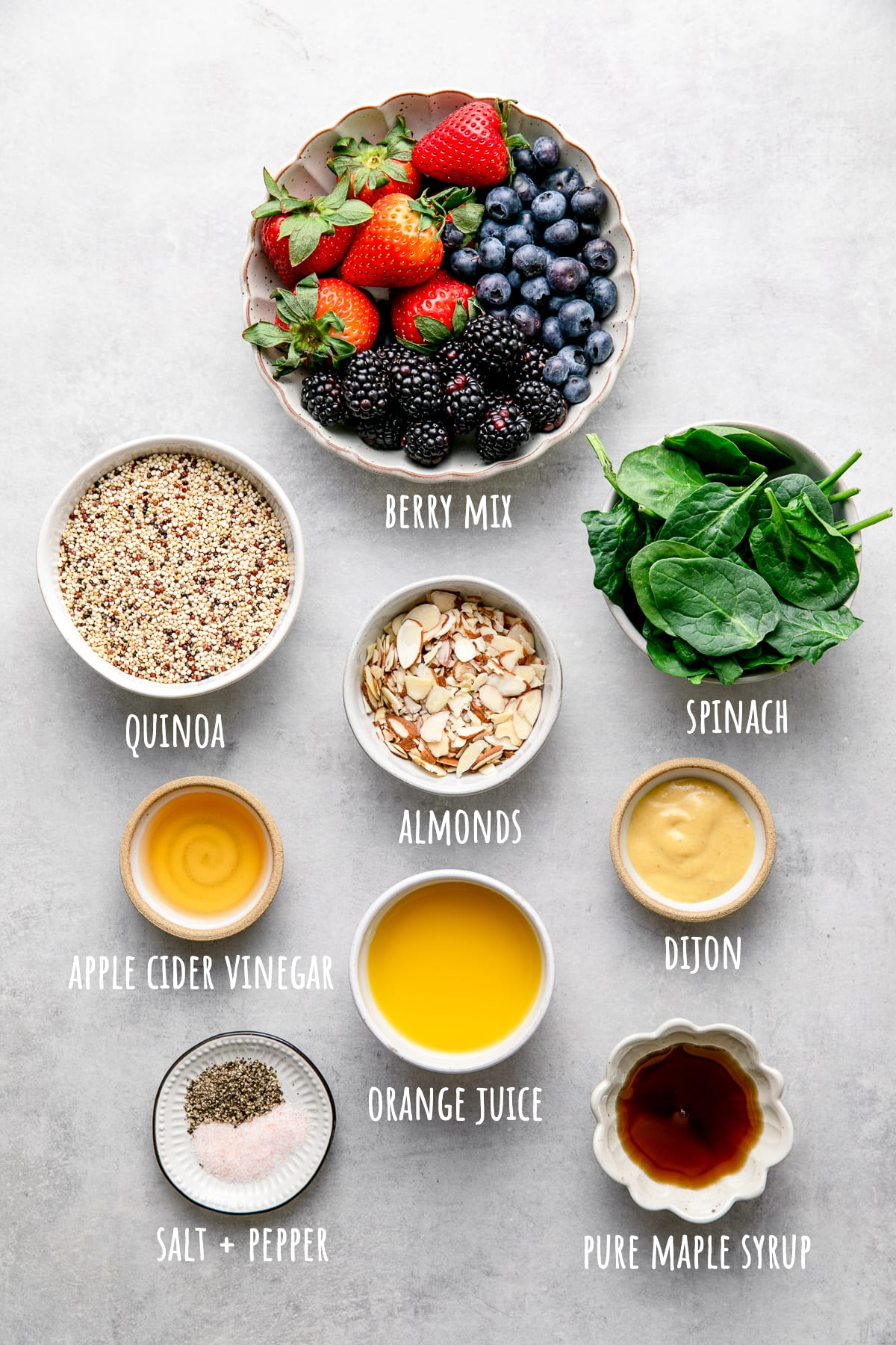 top down view of ingredients used to make berry spinach quinoa salad.