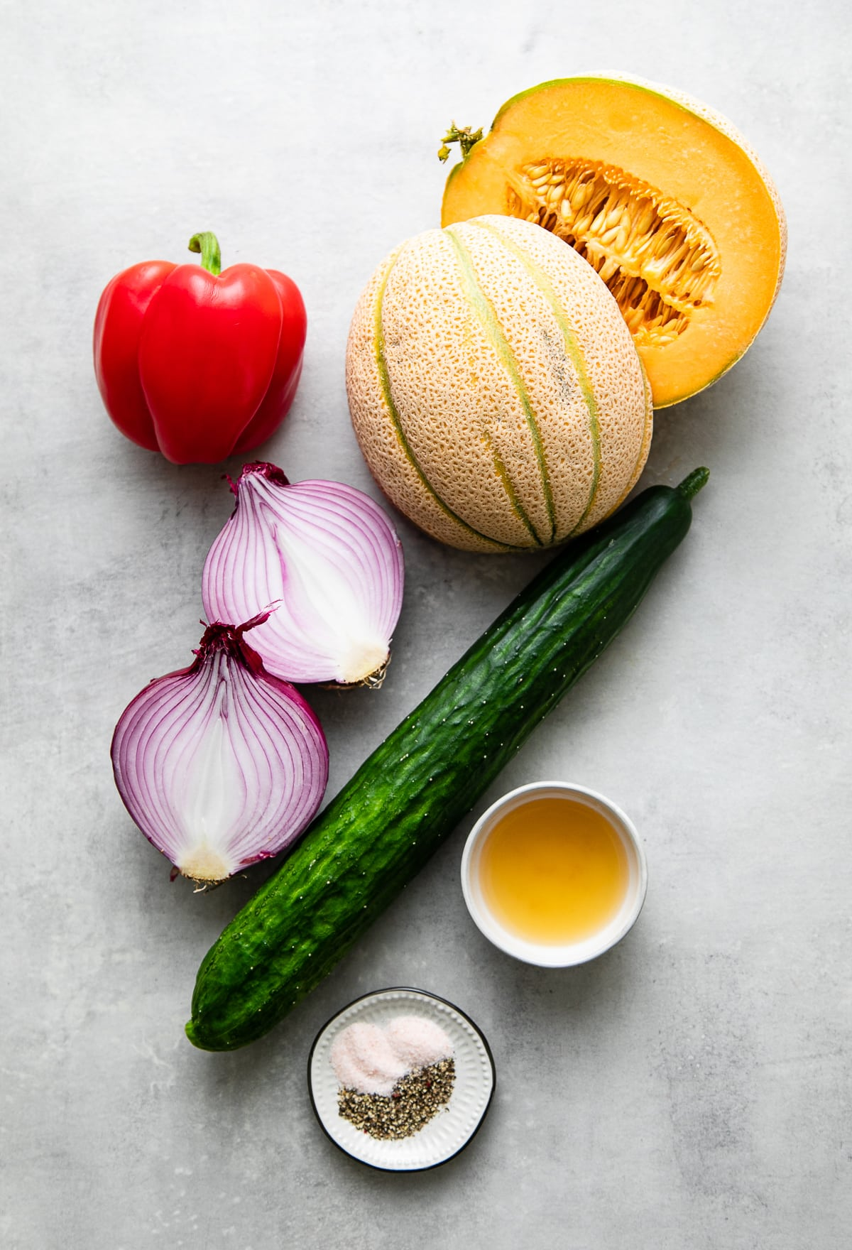 top down view of ingredients used to make healthy cantaloupe cucumber salad.