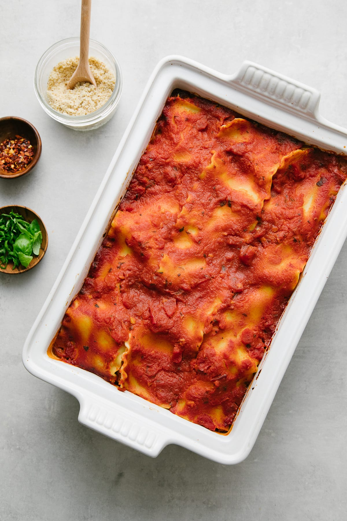 top down view of freshly made vegan lasagna in a baking dish.