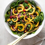 top down view of a large serving bowl filled with roasted delicata squash salad.