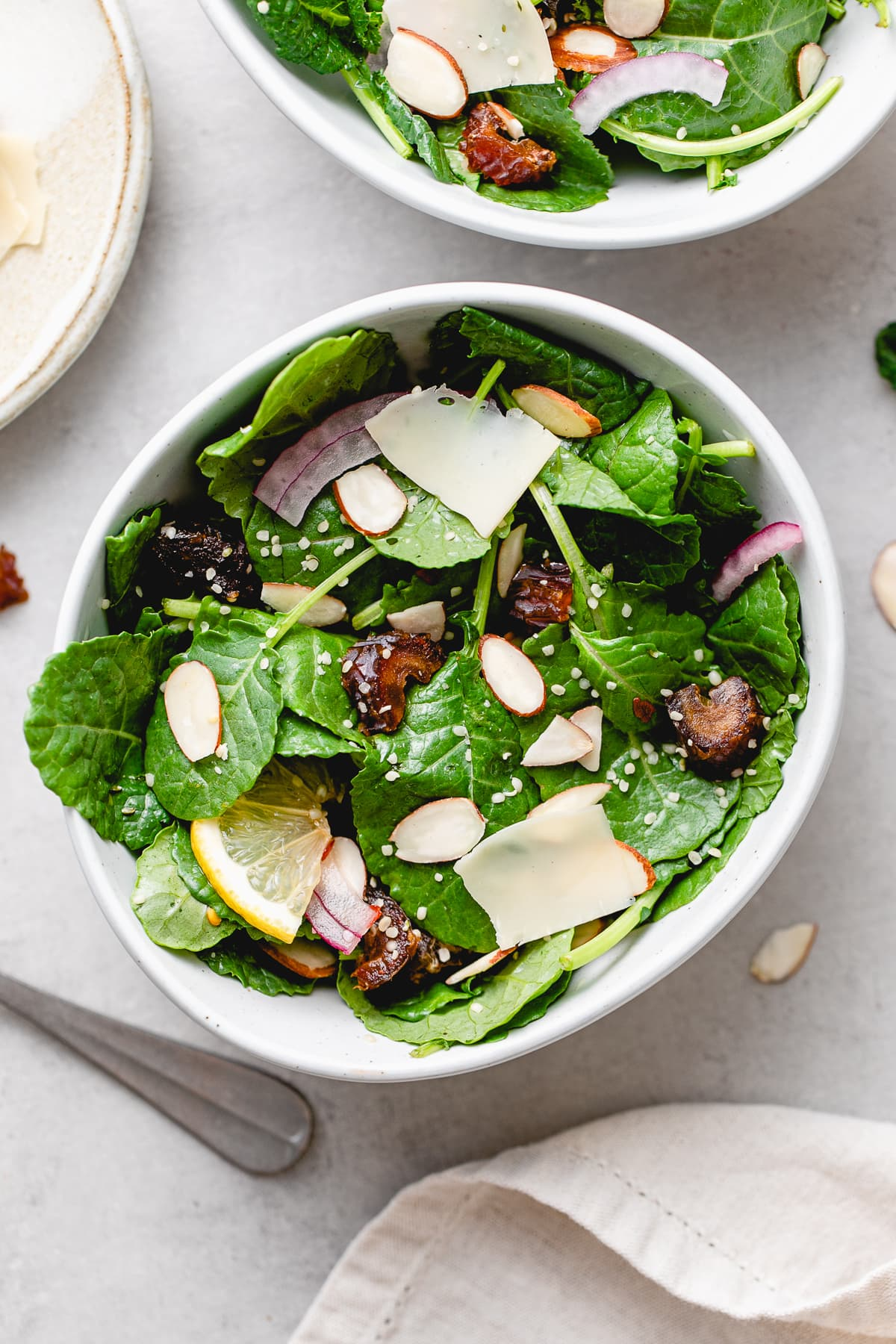 top down view of healthy kale salad with dates and almonds.