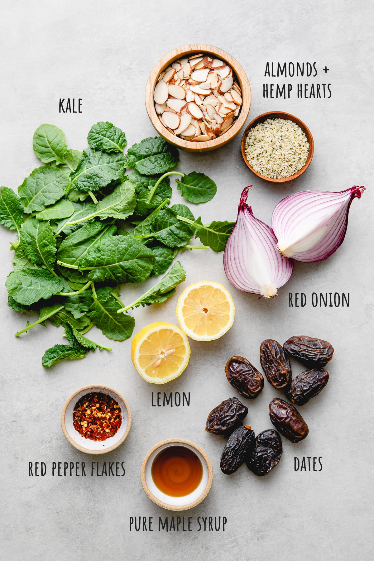 top down view of ingredients used to make healthy kale, date, and almond salad recipe.
