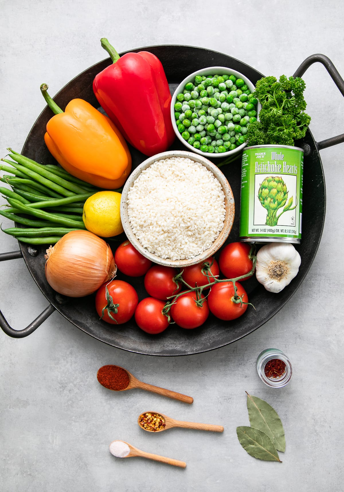 top down view of ingredients used to make vegan paella.