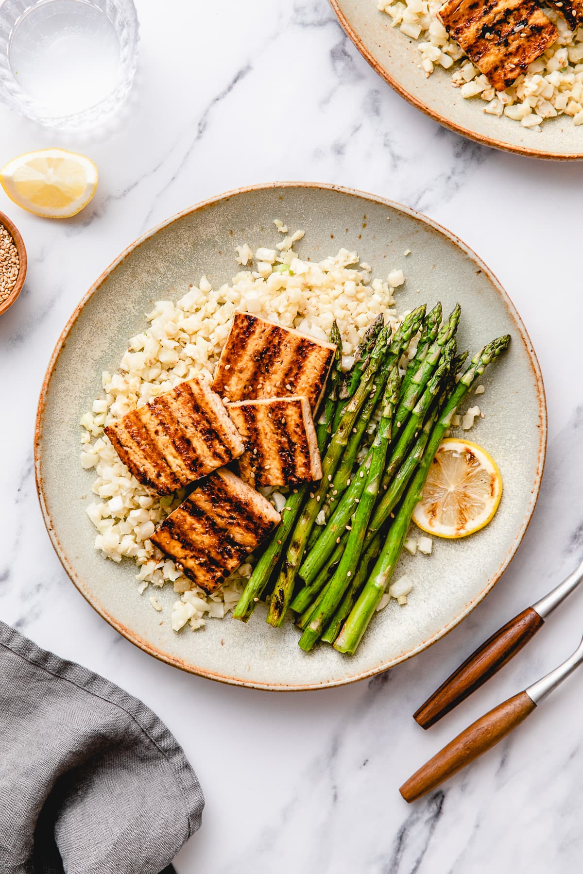 top down view of plated easy grilled tofu and asparagus with ginger cauliflower rice.