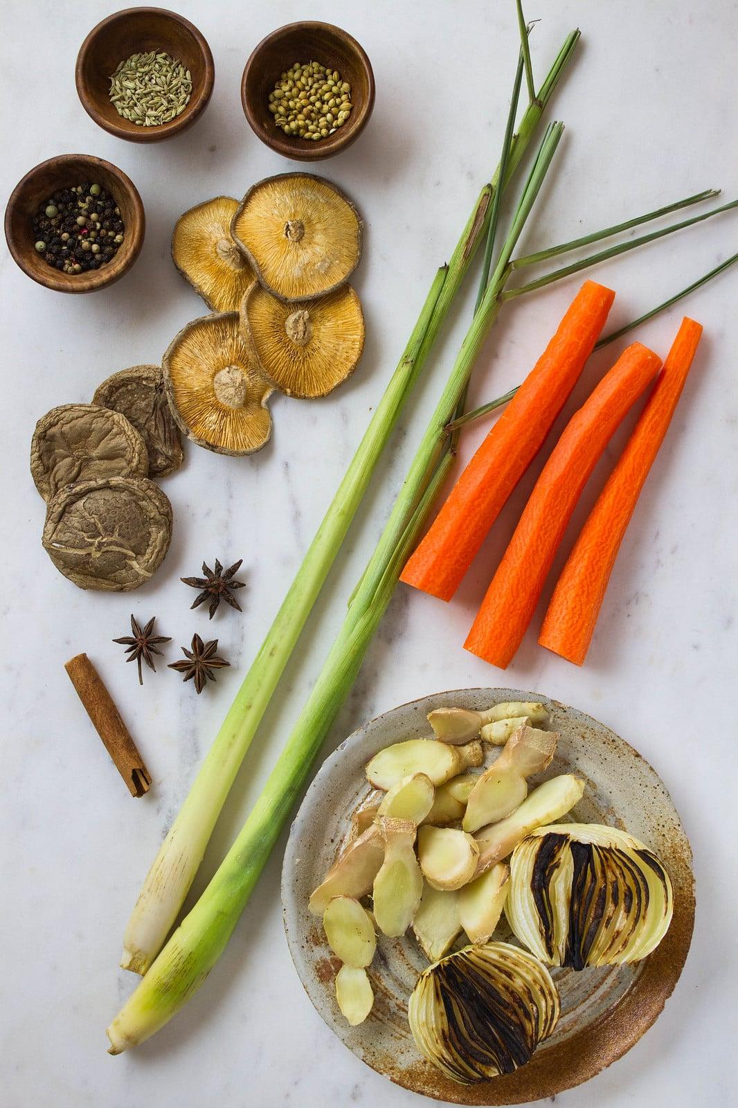top down view of ingredients to make vegan pho broth.