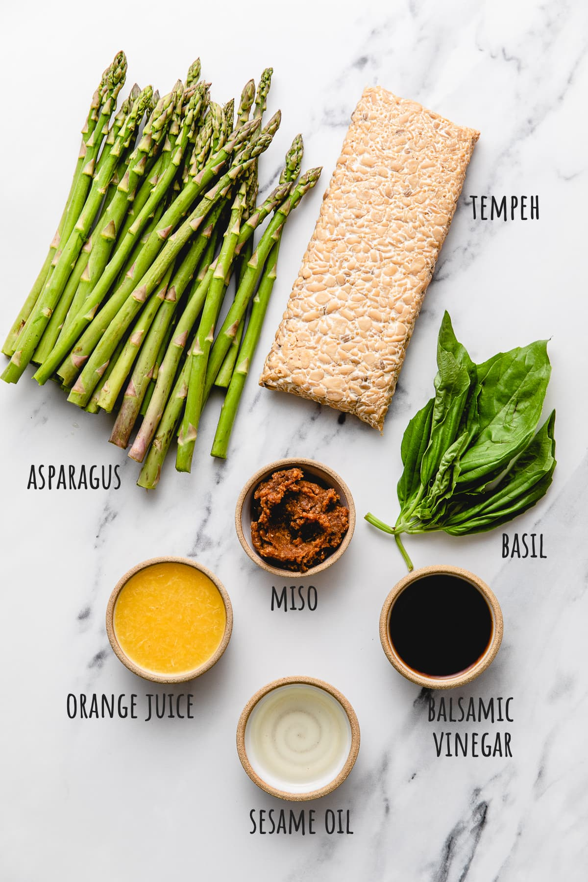 top down view of ingredients to make orange tempeh and asparagus recipe.