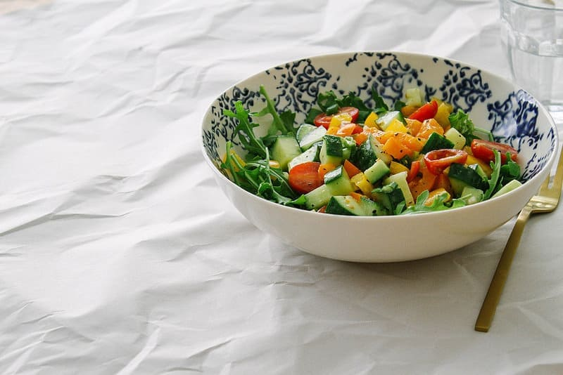 chopped vegetable salad with garlic dressing