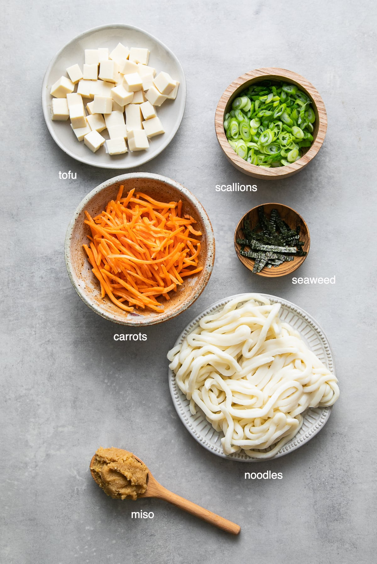 top down view of ingredients used to make miso noodle soup recipe with tofu.
