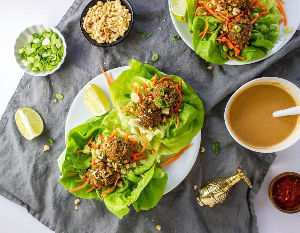top down view of lettuce wraps with thai quinoa meatbalss and peanut dipping sauce