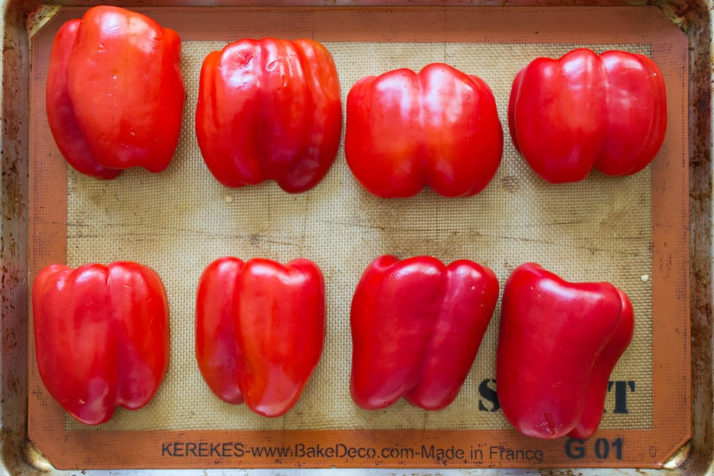 sliced red peppers prepped and ready for to be roasted in the oven.