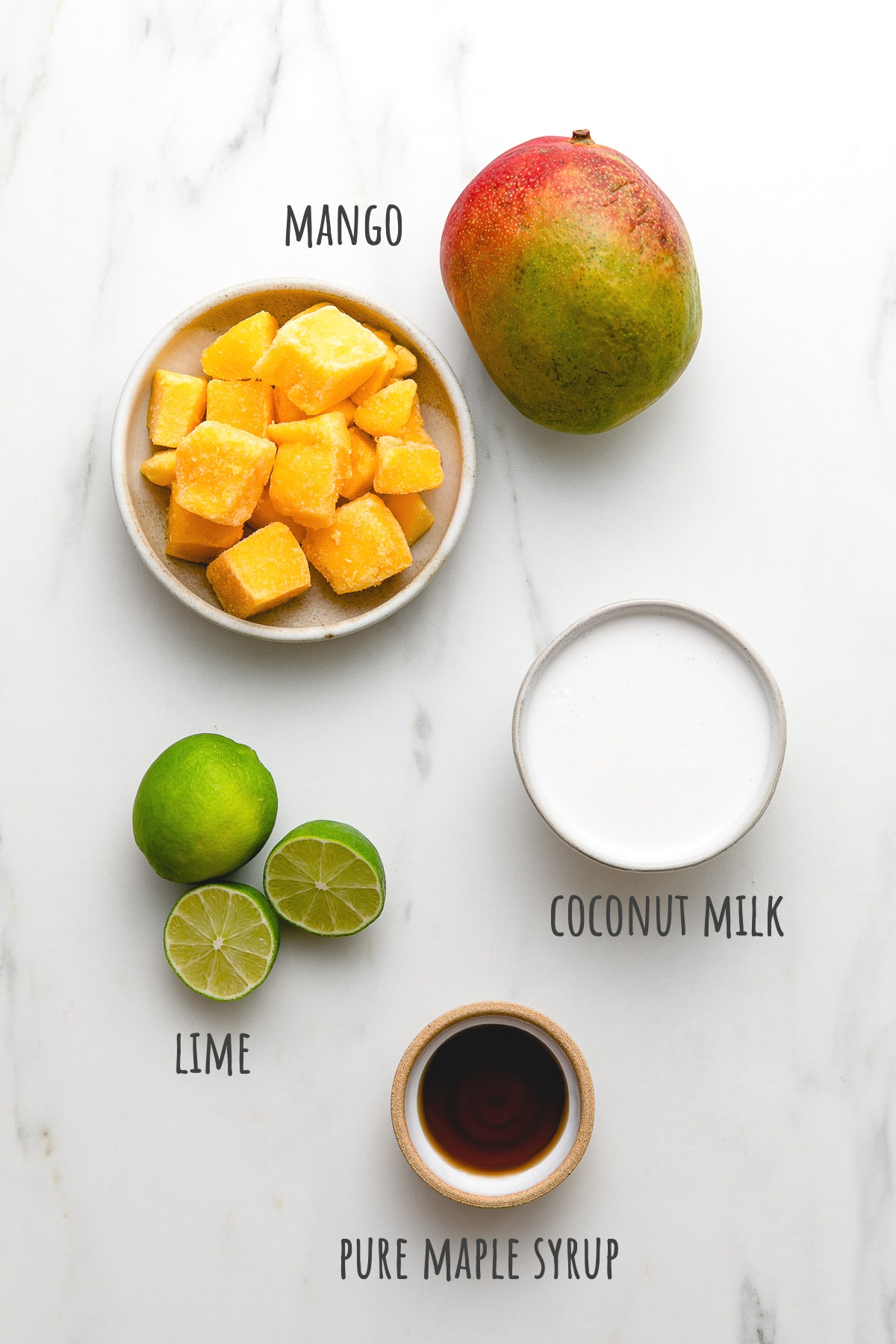 top down view of ingredients used to make mango coconut popsicles with granola.