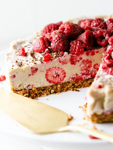 side angle view of no bake vegan cheesecake on a whith