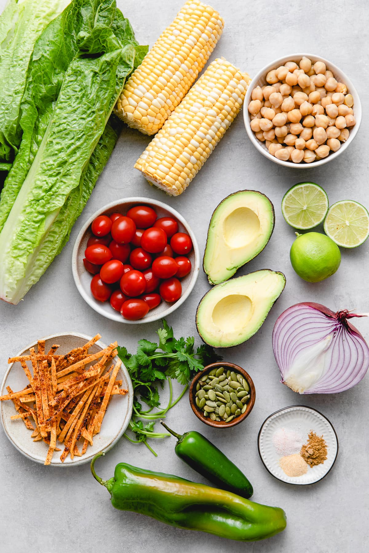top down view of ingredients used to make southwest chickpea salad with avocado dressing.